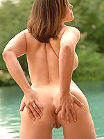 Liora gets naked in the pool