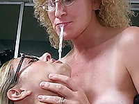 Two horny sluts have cum on their glasses
